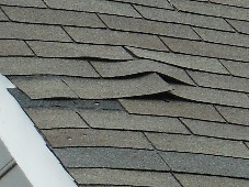 Improperly installed and loose shingles